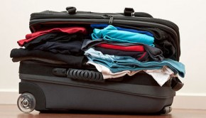 Suitcase stuffed with clothes